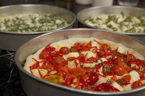 """At Mozza, when we press the toppings into the dough, we push ever so slightly outward, toward the edge of the pan. In so doing, we are killing three birds with one stone: embedding the topping into the dough, dimpling the dough and encouraging the dough toward the edges of the pan."""