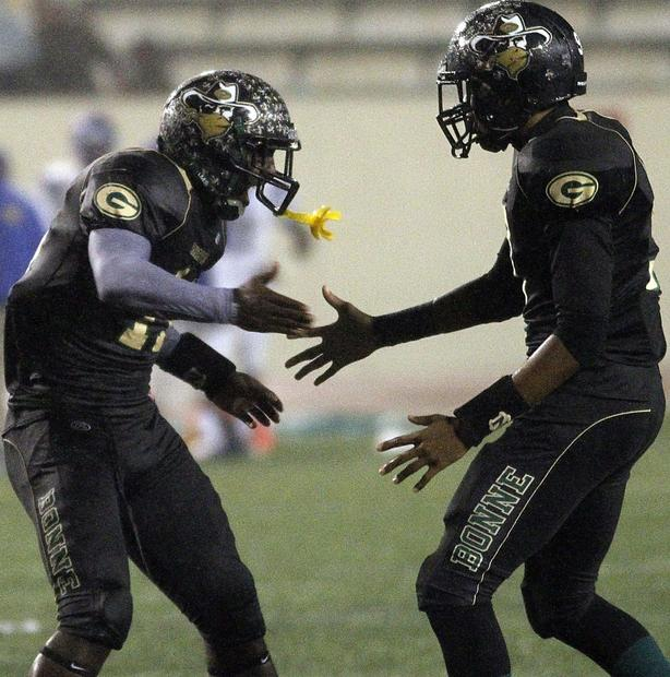 Narbonne wide receiver A.J. Richardson is congratulated by teammate Josh Collins after making a touchdown catch against Crenshaw in the fourth quarter of the City Section Division I championship Saturday at East Los Angeles College.