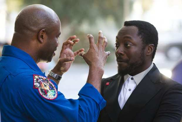 Astronaut Leland Melvin, left, talks to musician will.i.am at Jet Propulsion Laboratory.