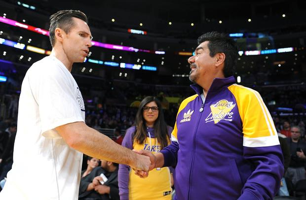 Lakers point guard Steve Nash greets George Lopez before the Christmas Day game against the Knicks.