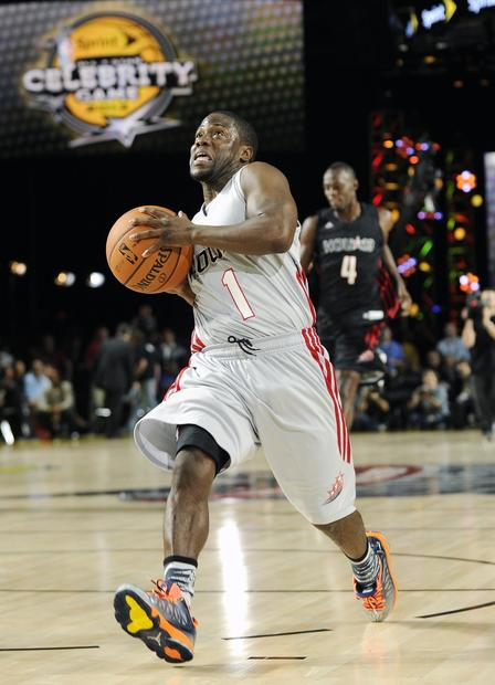 Comedian Kevin Hart scores on a breakaway layup during the first half of the celebrity game on Friday night in Houston.