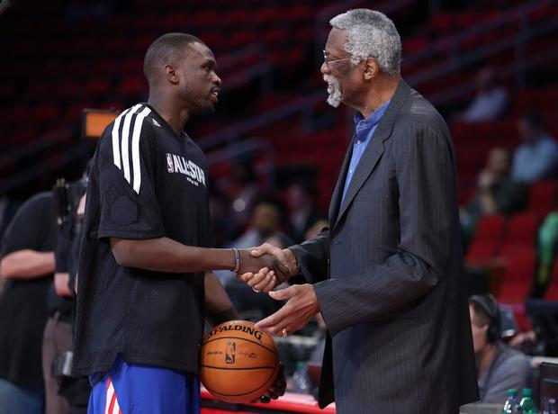 Bulls forward Luol Deng talks to Celtics Hall of Fame center Bill Russell before warming up for the game Sunday.
