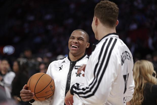 Western Conference All-Stars Russell Westbrook of the Thunder and Blake Griffin of the Clippers chat as they warm up for the all-star game Sunday.