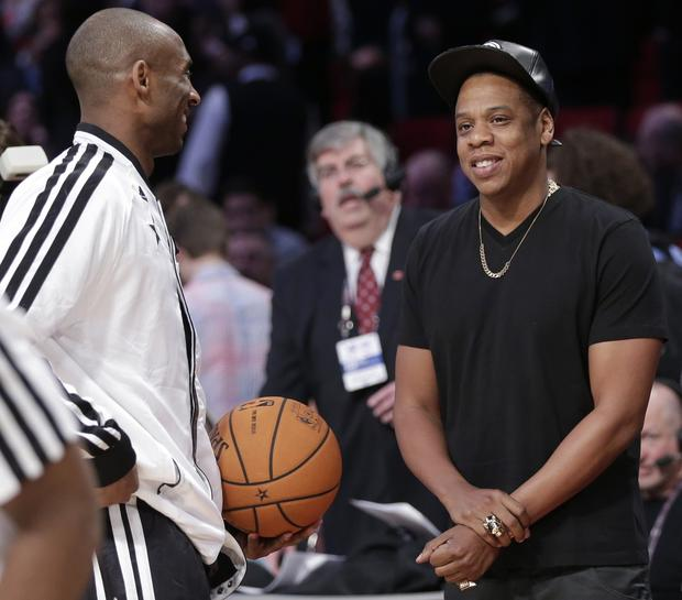 Lakers guard Kobe Bryant talks to Jay Z before the NBA All-Star game on Sunday.