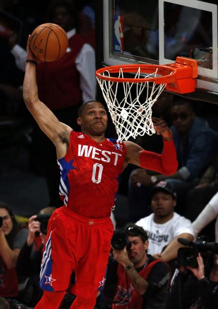 West guard Russell Westbrook of the Thunder elevates to the rim for a dunk in the first half Sunday in Houston.