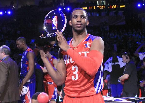 Clippers guard Chris Paul poses with the MVP trophy after helping the West defeat the East, 143-138, in the NBA All-Star game on Sunday night at the Toyota Center in Houston.