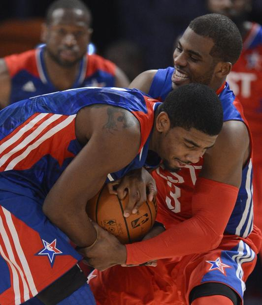 East guard Kyrie Irving of the Cavaliers fights to keep possession of the ball against West guard Chris Paul of the Clippers in the second half of the NBA All-Star game Sunday night.