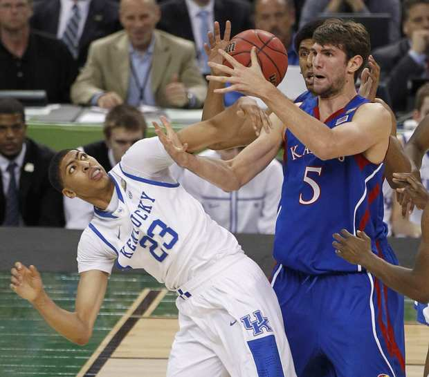 Centers Anthony Davis of Kentucky and Jeff Withey of Kansas battle for a rebound in the first half of the NCAA tournament final on Monday night in New Orleans.