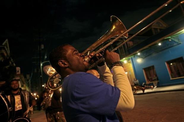 Marc Francis  of the Young Fellaz Brass Band hits a high note on Frenchmen Street in New Orleans.