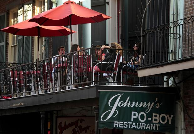 Diners enjoy the view -- and the food -- from a balcony at Johnny's  on St. Louis Street in the New Orleans French Quarter.