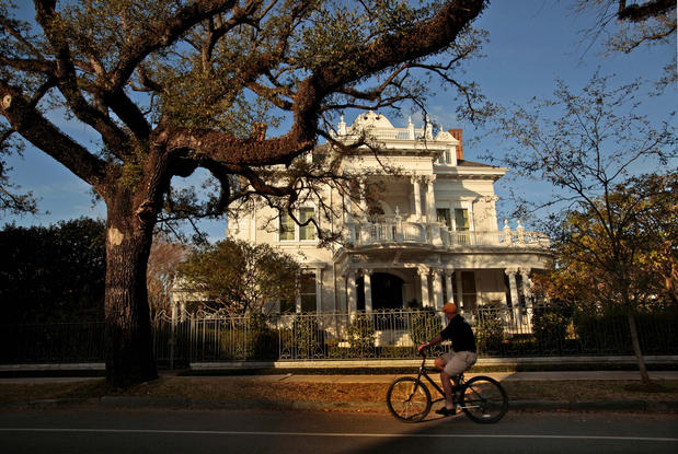 Mansions  are many along St. Charles Avenue in the Garden District. The best way to see them? The St. Charles streetcar.