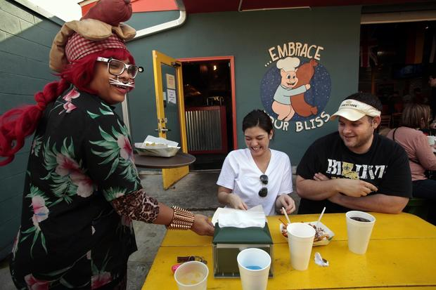 Waitress Mary Tillman gets in the Mardi Gras spirit at Dat Dog on Freret Street in New Orleans.