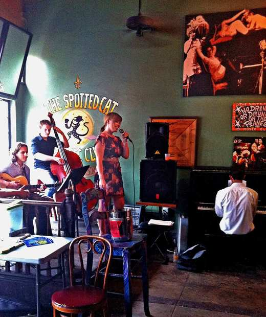 Meghan Stewart and the Reboppers perform a daytime set inside The Spotted Cat jazz bar.