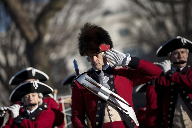 Members of the U.S. Army Old Guard Fife and Drum Corps perform on the National Mall amid preparations for Monday's inauguration ceremonies.