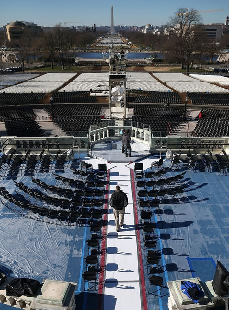 Workers make final preparations on the inauguration platform, constructed from scratch for each inaugural ceremony.