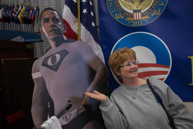 Lori Rennings of Lincoln, Neb., poses for a photo with a cutout of the president.