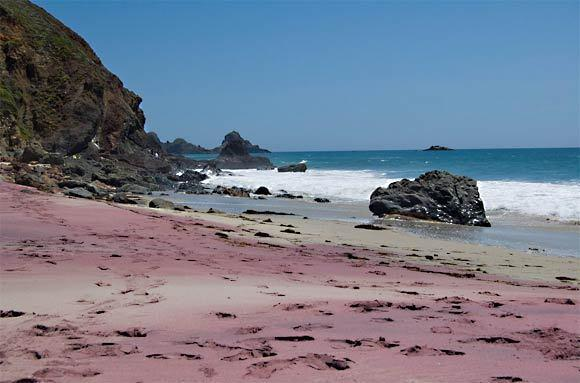 Sand derives its color from minerals that compose it, which vary from place to place. Quartz, often clear or translucent, is commonly the dominant ingredient, lending sand its generally light color. Pfeiffer Beach's purple color comes from manganese garnet deposits found in the surrounding rocks.