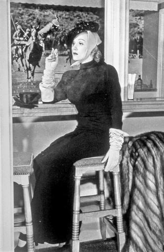 Marlene Dietrich is shown seated in the Polo Lounge at the Beverly Hills Hotel.