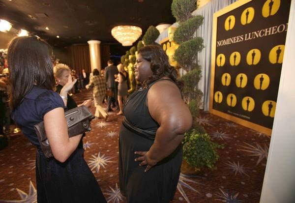 "The lead actress nominee for ""Precious: Based on the Novel 'Push' by  Sapphire"" chats before braving the line of photographers."