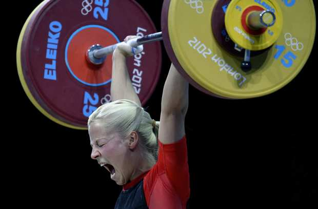 Germany's Julia Rohde competes during women's 58K weightlifting at the ExCel Center in London on Sunday.