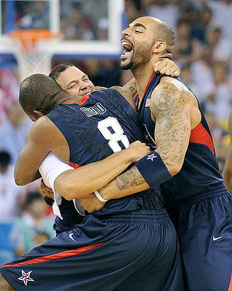 American teammates Michael Redd, Deron Williams and Carlos Boozer celebrate on the court after defeating Spain, 118-107, in the men's basketball final on Sunday in Beijing.