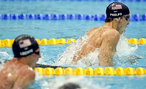 American swimmer Michael Phelps opens a lead on teammate Ryan Lochte during the 200-meter individual medley on Friday in Beijing.