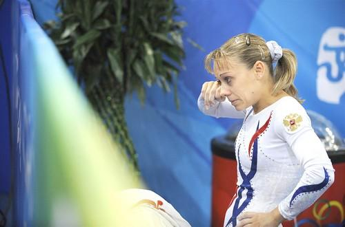 Russian gymnast Lyudmila Grebenkova wipes a tear after her balance beam routine, during which she fell.