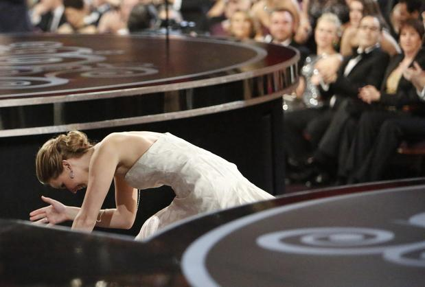 "Jennifer Lawrence trips on the stairs on her way to accept the Oscar for lead actress. To the audience, which rose to its feet in support, she said, ""You guys are just standing up because you feel bad that I fell and that¿s embarrassing."""