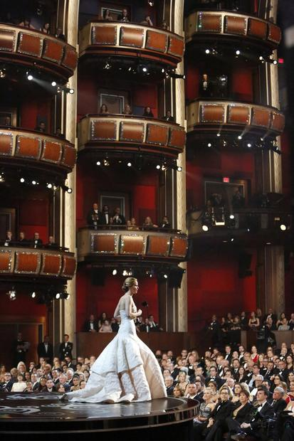 "Jennifer Lawrence accepts the lead actress Oscar for her performance as an emotionally unstable widow in ""Silver Linings Playbook."""