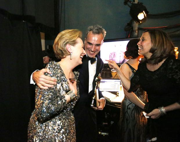 "Meryl Streep and Daniel Day-Lewis embrace backstage after Day-Lewis accepted the lead actor Oscar for his performance in ""Lincoln."""