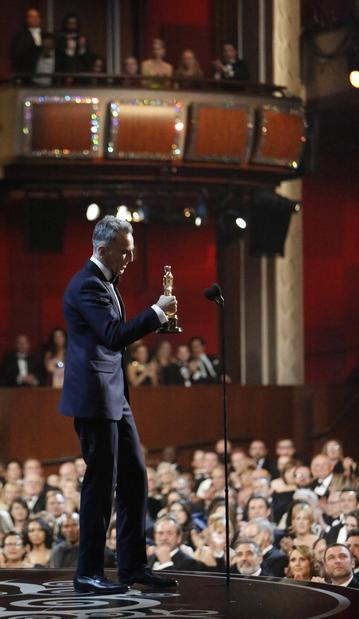 "Daniel Day-Lewis accepts the lead actor Oscar for his performance as the title character in ""Lincoln."""