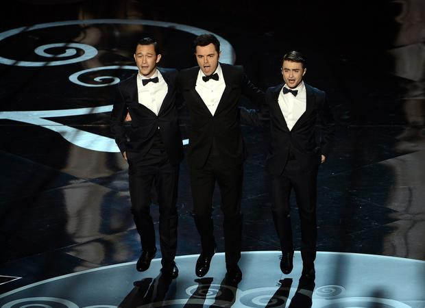 Joseph Gordon-Levitt, left, Seth MacFarlane and Daniel Radcliffe dance onstage during the Oscars opening number.