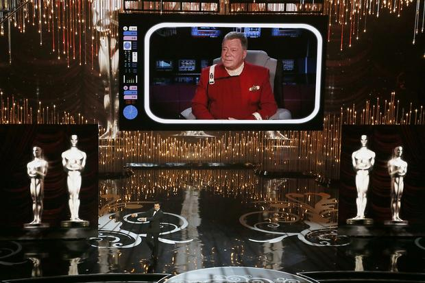 "William Shatner makes a video appearance as his ""Star Trek"" character, Capt. Kirk, visiting from the future to warn Oscar host Seth MacFarlane that his tasteless jokes and musical numbers would ruin the Academy Awards."