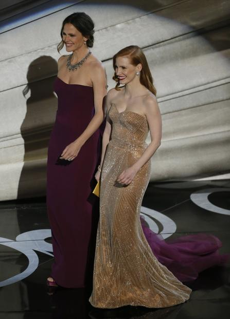Jennifer Garner, left, and Jessica Chastain walk onstage to present the Oscar for foreign language film.