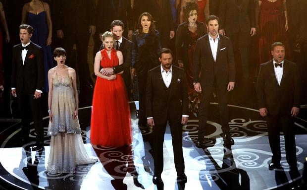 """Les Misérables"" actors, from left, Aaron Tveit, Anne Hathaway, Amanda Seyfried, Eddie Redmayne, Samantha Barks, Hugh Jackman, Helena Bonham Carter, Sacha Baron Cohen and Russell Crowe perform songs from the movie."