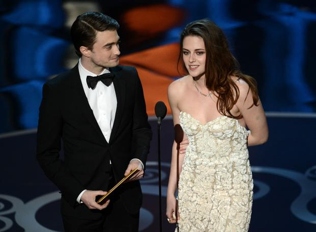 Daniel Radcliffe and Kristen Stewart present the Oscar for production design.