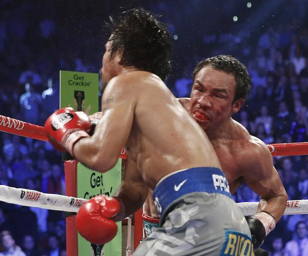 Manny Pacquiao is knocked out by Juan Manuel Marquez in the final second of the sixth round during their WBO welterweight fight at the MGM Grand Garden Arena in Las Vegas.