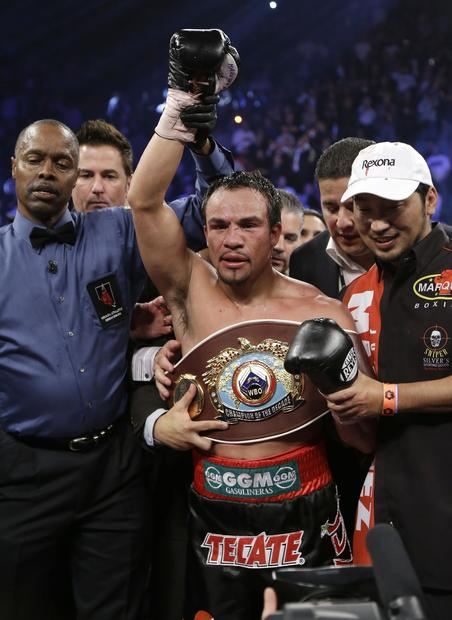 "Referee Kenny Bayless declares Juan Manuel Marquez the winner after he knocked out Manny Pacquiao in a WBO welterweight fight in Las Vegas. The WBO declared Marquez, who had lost twice to Pacquiao by decision and earned one draw, the ""Champion of the Decade."""