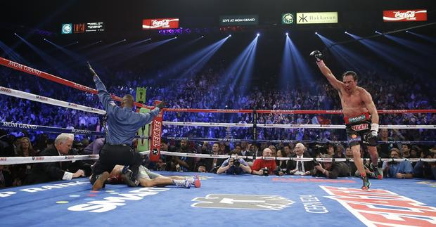 Juan Manuel Marquez reacts as referee Kenny Bayless calls out Manny Pacquiao at the end of the sixth round in their WBO welterweight fight in Las Vegas.