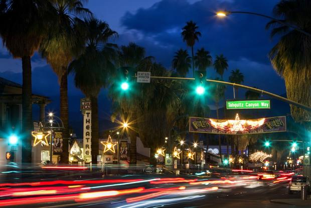 Dusk on South Palm Canyon Drive at Tahquitz Canyon Way. The Plaza Theatre, at left, is home to the Fabulous Palm Springs Follies.