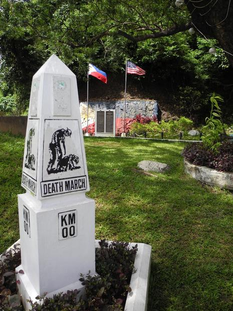This marker notes the starting point of the Bataan Death March, following the surrender of American and Filipino troops, the largest in U.S. and Philippines history.