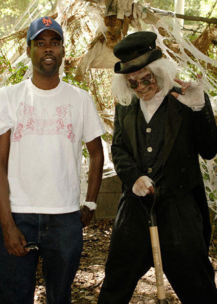 Comedian Chris Rock looks a little surprised by a shovel-wielding crypt keeper during Fright Fest at Six Flags Magic Mountain.
