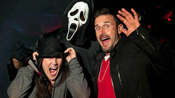 """Dancing with the Stars"" co-stars Ricki Lake and David Arquette scream for their lives as Ghostface attacks during Halloween Horror Nights at Universal Studios Hollywood."