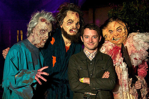 """Lord of the Rings"" star Elijah Wood seems unfazed by the trio of monsters surrounding him during Halloween Horror Nights at Universal Studios Hollywood."