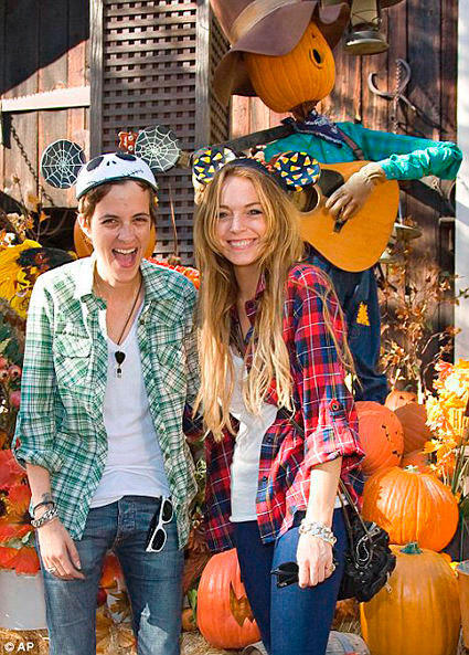 """Mean Girls"" actress Lindsay Lohan, right, and gal pal Samantha Ronson sport Halloween-themed Mickey Mouse ears during Halloween Time at Disneyland."