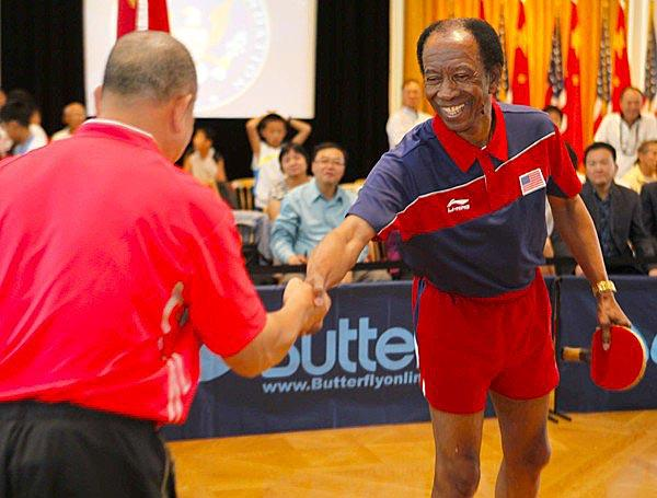 American player George Braithwaite greets Liang Geliang of China before their rematch on Thursday during the 40th anniversary celebration of their 1971 pingpong diplomacy meeting.