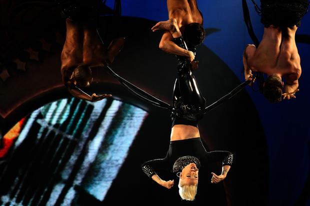 Pink hangs upside down during her performance Saturday at Staples Center.