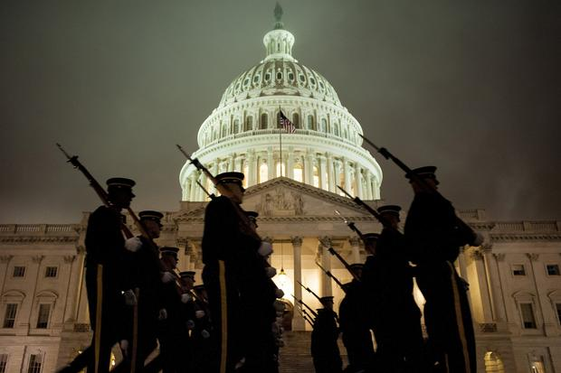 A U.S. Army Honor Guard rehearses for the presidential inaugural ceremonies in front of the Capitol in Washington.