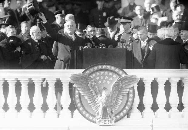 President Franklin Delano Roosevelt, seen waving from the inaugural stand on Capitol Hill in Washington in 1941.