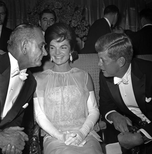 Vice President Lyndon B. Johnson chats with President Kennedy and Jacqueline Kennedy at the inaugural ball in the Mayflower Hotel in 1961.